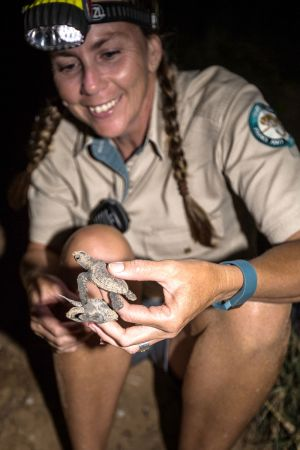 Image of Ranger Cathy Gatley with hatchling.